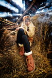 Beautiful woman relaxing in straw in autumn Stock Images