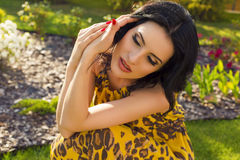 Beautiful woman relaxing at summer garden Royalty Free Stock Photo