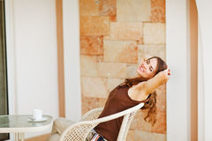 Beautiful woman relaxing on terrace Stock Images