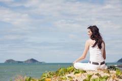 Beautiful woman relaxing on tropical beach Stock Photos