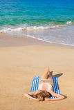 Beautiful Woman Relaxing on Tropical Beach Royalty Free Stock Photo