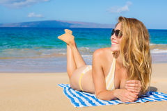 Beautiful Woman Relaxing on Tropical Beach Stock Photos