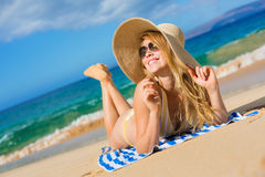 Beautiful Woman Relaxing on Tropical Beach Stock Photo