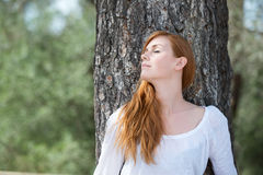 Beautiful woman relaxing in woodland Royalty Free Stock Photo