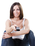 Beautiful woman with remote control Royalty Free Stock Photography