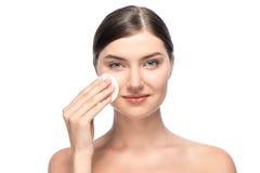 Beautiful woman removing facial make-up Stock Image