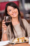 Beautiful woman at a restaurant Stock Photos