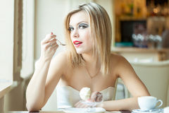 A woman in the restaurant is eating ice cream Royalty Free Stock Photography