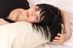Beautiful woman resting in the bed Stock Photography