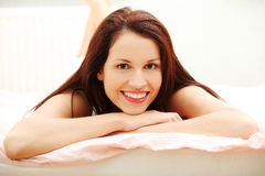 Beautiful woman resting in the bed. Royalty Free Stock Image