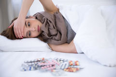 Beautiful woman resting in bed at home Stock Photography