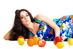 Beautiful woman resting with fresh fruits Stock Photo