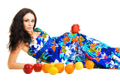 Beautiful woman resting with fresh fruits Stock Images