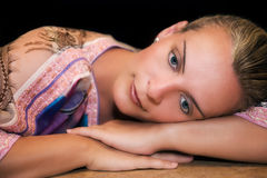 Beautiful woman resting on her arms and thinking Royalty Free Stock Image