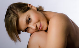 Beautiful woman resting her chin on knee Stock Photo