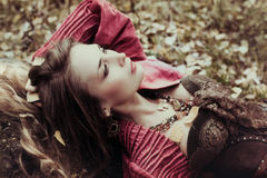 Beautiful woman is resting on the nature. Beautiful woman is resting on the nature in the autumn Royalty Free Stock Image