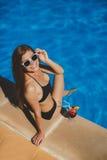Beautiful woman resting near pool at Maldives. Stock Photos