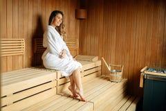 Beautiful woman resting in sauna royalty free stock photo