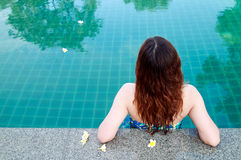 Beautiful woman resting in swimming pool Royalty Free Stock Images