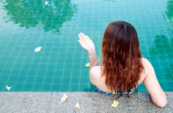 Beautiful woman resting on swimming pool Stock Images