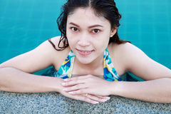 Beautiful woman resting on  swimming pool Stock Photo