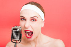 Beautiful woman with retro microphone Stock Images