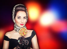 Beautiful woman in retro pin up style with lollipop on the brigh Royalty Free Stock Images