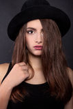 Beautiful woman in retro style with black mafia hat - Stock Image Stock Image