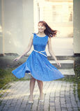 Beautiful woman in retro style dress whirl Royalty Free Stock Image