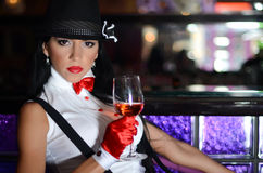 Beautiful woman in retro style drink wine Royalty Free Stock Images