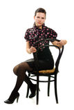 Beautiful woman in retro style sitting on a chair Stock Photos