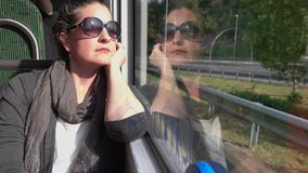 Beautiful woman rides bus in Spain stock video