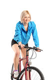 Beautiful woman riding a bicycle Stock Photography