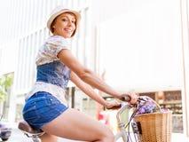 Beautiful woman riding on bike Royalty Free Stock Image