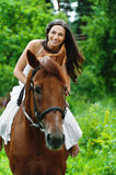 Beautiful woman riding horse Royalty Free Stock Photos