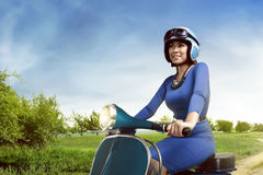 Beautiful woman riding scooter Royalty Free Stock Photos