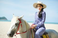 Beautiful woman riding a horse at the beach royalty free stock photo