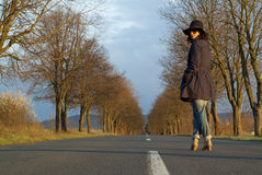 Beautiful Woman on a Road Stock Image