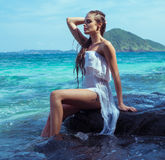 Beautiful woman on the rock Royalty Free Stock Images
