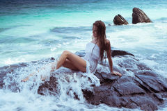 Beautiful woman on the rock Stock Photo