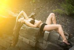 Beautiful woman among the rocks Stock Photo