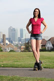 Beautiful woman roller skating in London England Royalty Free Stock Photography