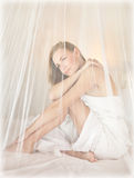 Beautiful woman in romantic bedroom Royalty Free Stock Photo
