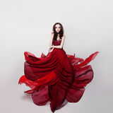 Beautiful Woman in Romantic Red Dress royalty free stock images