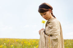 Beautiful woman in a romantic wildflower meadow Stock Photo