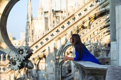 Beautiful woman on on the rooftop of Duomo, Milan Stock Photo