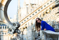 Beautiful woman on on the rooftop of Duomo, Milan Stock Photography