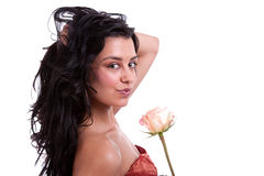 Beautiful woman with a rose. On white, studio shot Royalty Free Stock Images