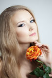 Beautiful woman with a rose. In his hand Stock Images