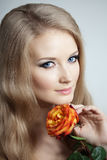 Beautiful woman with a rose. In his hand Stock Photo